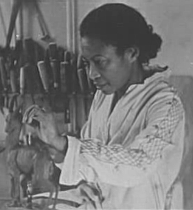 African American woman artist carving a sculpture